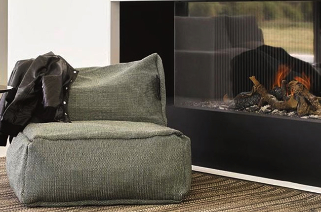 Roolf chair in front of a black fire place