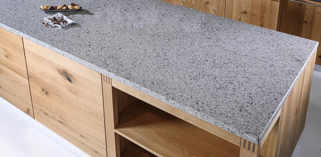 Strasser countertop grey stone on oak kitchen island
